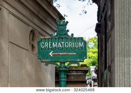 Paris, France - September 11 2019: Rusty Crematorium Sign In Pere Lachaise Cemetery - Paris, France.