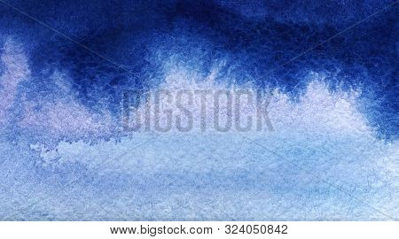Abstract Hand Drawn Background Of Shining Blue Sky With Clouds. Watercolor Texture With Granulation.