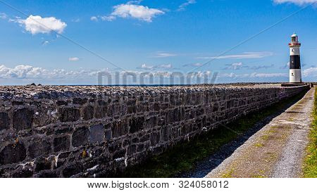 Limestone Fence Next To A Road In Direction The Lighthouse On Inis Island Oirr Island, Wonderful Sun