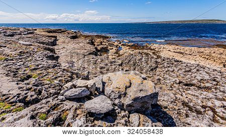 View Of The Limestone Rocky Coastline Of The Island Of Inis Oirr With The Atlantic Ocean In The Back