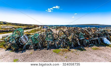Stack Of Old Lobster / Crab Cages Or Fishing Traps Found On The Coast On Inis Oirr Island, The Ocean