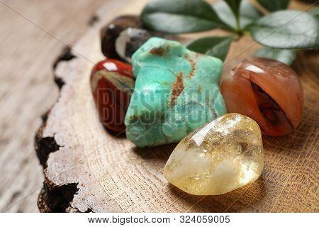 Citrine Quartz And Beautiful Gemstones On Wooden Stand, Closeup