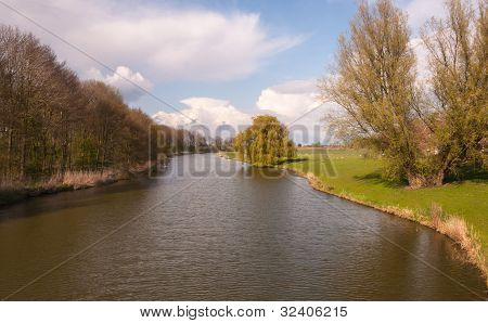 Landscape With Small River And Weeping Willow Tree At The Banks