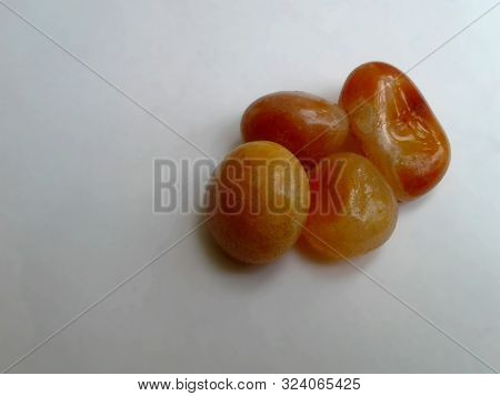 Tumbled Agate Healing Stone. Orange Agate. Four Stone On A White Background.agate Is Excellent For B