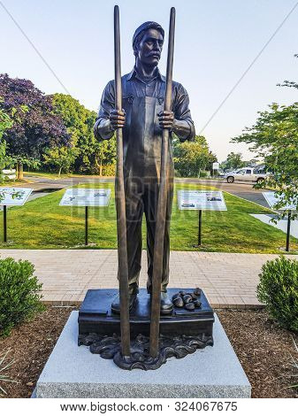 Babylon, New York, Usa - 2 July 2018: Babylon Villages Bayman Statue Dedicated To The Men Who Clamed