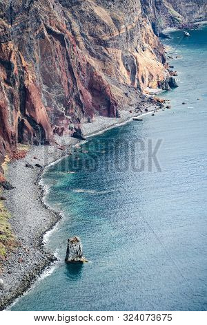 Turquoise Water Beach At The Foot Of A Rocky Cliff In Madeira
