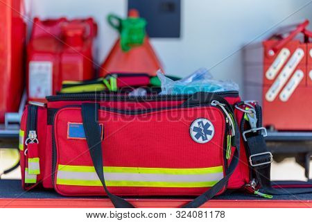 First Aid Kit An Open  Red First Aid Kit Bag With A Black Zip And Handle, In Closeup. And Handle In