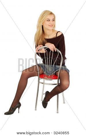 Pretty Young Girl Sitting On A Chair