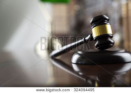 Judge Concept. Gavel Of  The Judge On The Bookshelf Background.