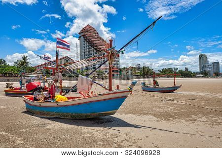 Local Fishing Boat Moored On The Beach At Low Tide In Prachuap Khiri Khan Province, Thailand