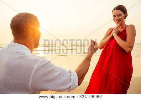 Male Making Proposal With Engagement Ring To His Girlfriend At Sea Beach.valentines Day February 14
