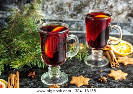Christmas Mulled Wine With Ginger Biscuits Orange Cinnamon Clove Anise And Fir Tree On The Dark Tabl