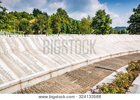 Potocari, Bosnia And Herzegovina - July 31, 2019. Memorial Desk With The List Of Genocida Victims In