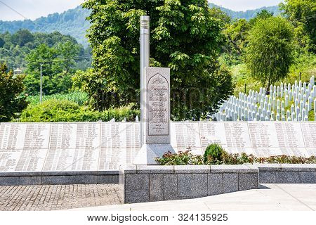 Potocari, Bosnia And Herzegovina - July 31, 2019. Gravestone With Arabic Letters In Memorial To The