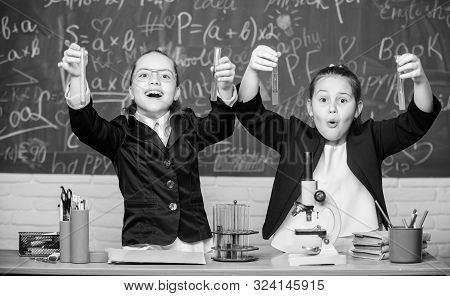School Experiment. Girls School Uniform Excited Proving Their Hypothesis. School For Gifted Children