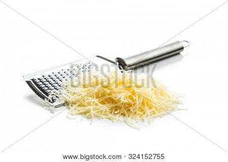Tasty grated cheese and grater. Parmesan cheese isolated on white background.