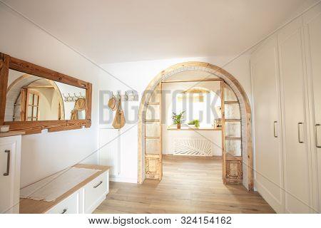Big Wooden Handmade Mirror In Hallway Boho Interior. Home Indoors Design Concept.
