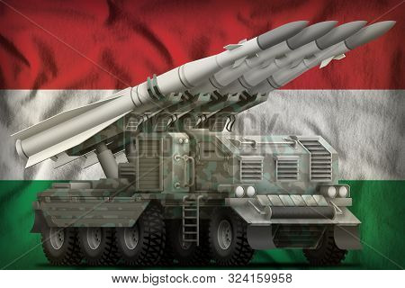 Tactical Short Range Ballistic Missile With Arctic Camouflage On The Hungary Flag Background. 3d Ill