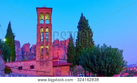 Bell tower of Holy Temple of Dormition of the Virgin Mary in Kalabaka town at twilight,  Thessaly, Greece - Landscape