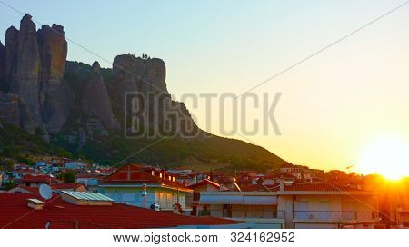 The Meteora rocks and roofs of Kalabaka town at sunrise, Thessaly, Greece - Landscape