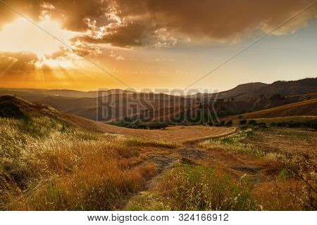Majestic Sunset In Mountains Landscape. Beautiful Sky With Clouds And Sun Rays Shine. Mountains Suns