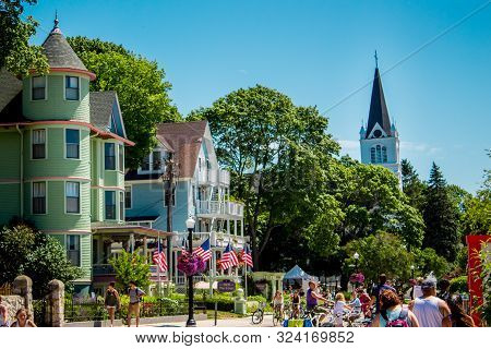 Mackinac Island Mi /usa - July 9th 2016:  Sainte Anne Church Peaking Up Over The Tree Line From Down