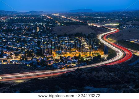 Twilight view of commuter freeway traffic in suburban Simi Valley near Los Angeles in Ventura County, California.