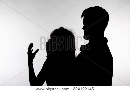 Domestic violence and abuse concept - Silhouette of man beating defenseless woman poster