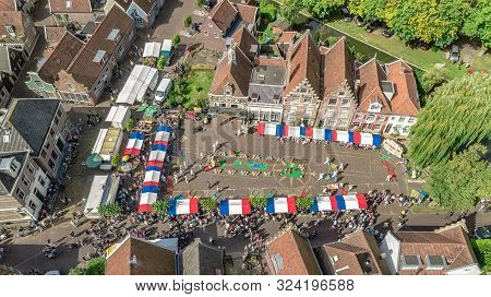 Aerial Drone View Of Traditional Cheese Market In Edam From Above, Architecture And Cheese Market Sq