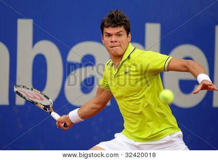 BARCELONA - APRIL, 25: Canadian tennis player Milos Raonic in action during his match against Igor Andreev of Barcelona tennis tournament Conde de Godo on April 25, 2012 in Barcelona
