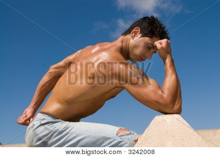 Muscular Male Body Under The Blue Sky