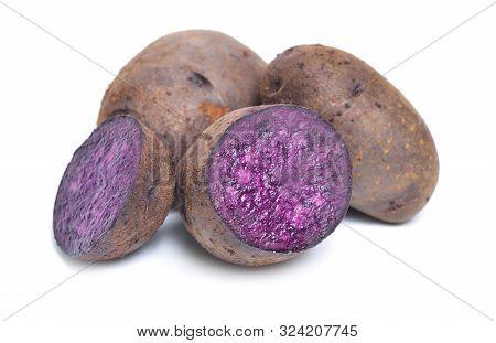 Potato Vitelotte, Also Called Vitelotte Noire, Negresse Or Truffe De Chine. Isolated On White Backgr