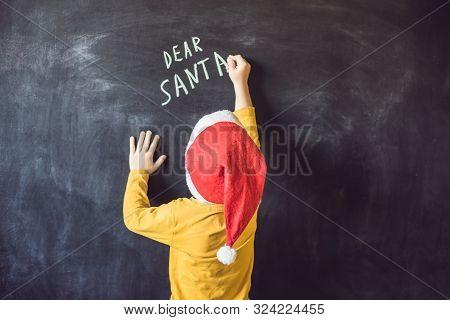 Dear Santa. The Boy Wrote A Message For Santa Claus. Christmas