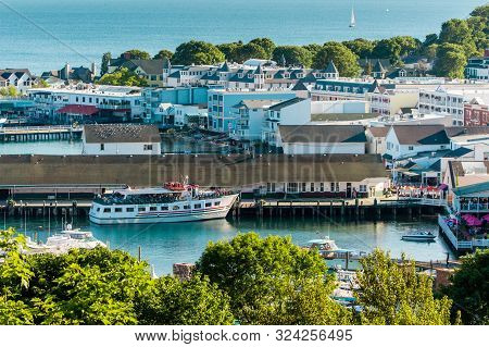 Mackinac Island Mi /usa - July 9th 2016: The Mackinac Island Harbor And Downtown During The Middle O