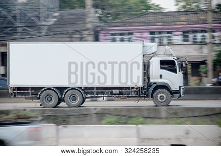 Samutsakhorn, Thailand - March,2018: Motion Image Of Small White Truck On The Road  Logistics Busine