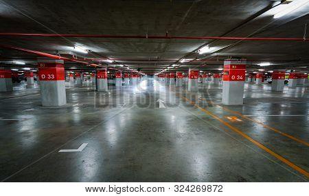 Empty Underground Car Parking Lot. Underground Car Parking Garage At Shopping Mall Or International