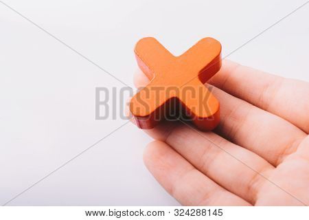 Hand holding letter cube T of made of wood poster