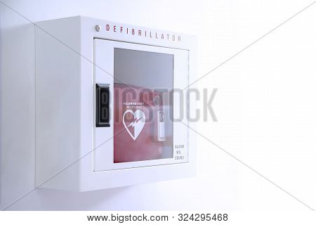 Automated External Defibrillator (aed) In White Box On The Wall Is An Emergency Pacemaker Device For