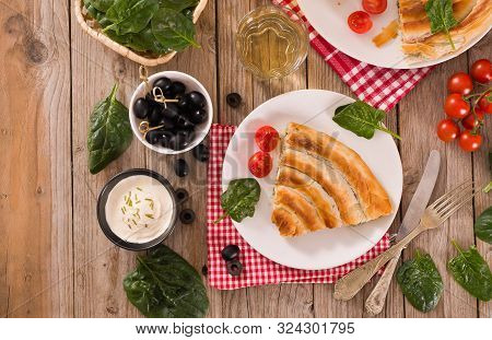 Spanakopita, Greek Spinach Pie On White Dish.