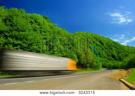 Heavy Truck On The Road. Motion Blur.