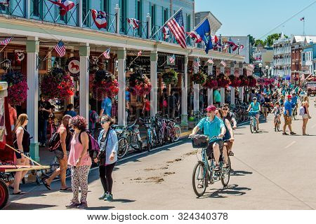 Mackinac Island Mi /usa - July 9th 2016: Tourists Getting Around Mackinac Island By Bike