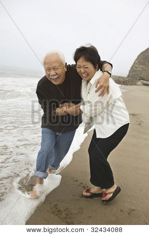 Mature Couple Playing in Water