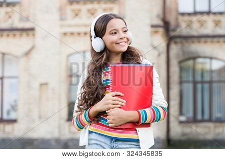 Do You Speak English. Happy Child Listening To English Audio Course. Little Girl Learning English Wi