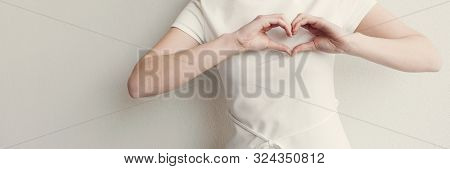 Happy Asian Young Woman Making Her Hands In Heart Shape, Heart Health Insurance, Social Responsibili