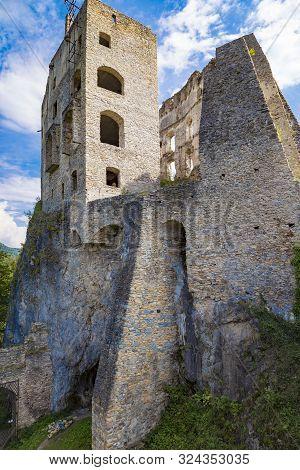 Scenic Ruins Of Ancient Castle  Likava On Rock On Blue Cloudy Sky Background. Liptov Region. Slovaki