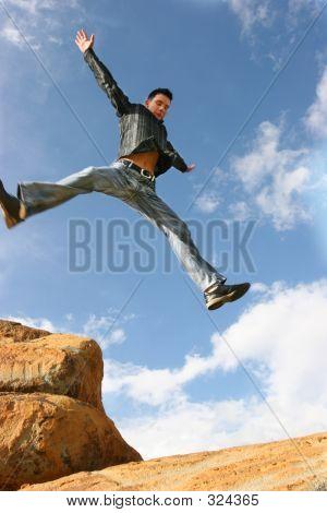 Man Jumping Of Joy