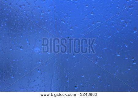 Waterdrops On Blue Transparent Window