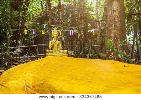 poster of Buddha statue beautiful On the way up at The stone with the footprint of Lord Buddha at Khitchakut mountain It is a major tourist attraction Chanthaburi, Thailand.