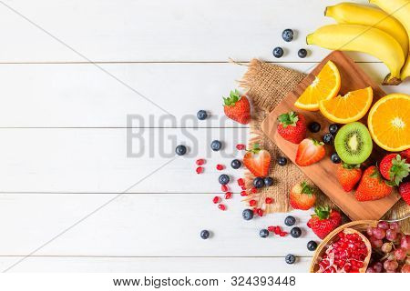 Mixed Fresh Fruit Salad With Strawberry, Blueberry, Orange On Wooden White Background. Diet Fruits C