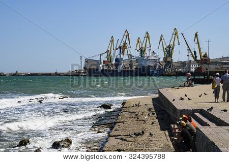 Feodosia, Crimea, Russia - September 11, 2019: Feodosia Commercial Port View From The Waterfront.